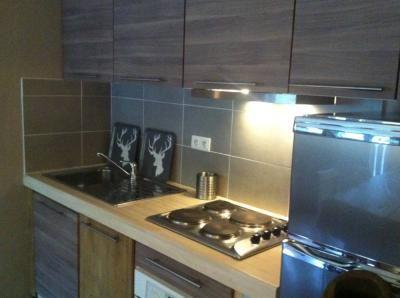 Open-plan kitchen Location Apartment 58747 Valmorel