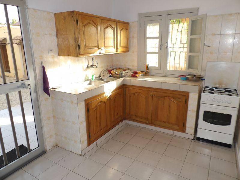 Open-plan kitchen Location Apartment 111793 Saly