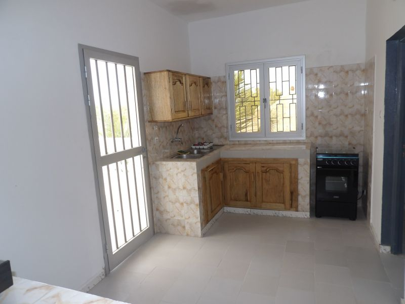 Open-plan kitchen Location Apartment 112467 Saly