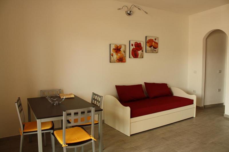 Living room Location Apartment 61212 Isola Rossa